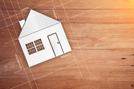 mortage: real estate concept with house symbol on wooden background and copy space for your text Stock Photo