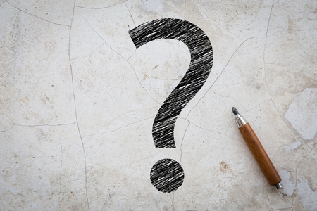 tree service business: sketch of question mark on grey concrete faq concept