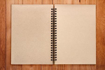 sketchbook: Open Vintage recycle Sketchbook with wooden plank texture  background