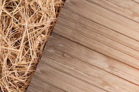 balcony view: dry old hay with old rustic wooden floor top view with free copy space for your text