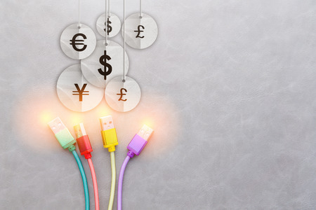 international money: USB Cable with international money currency symbol on grey Background business concept