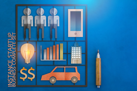 model kit: business startup instance tools kits with paper cut flat style object business concept.jpg Stock Photo