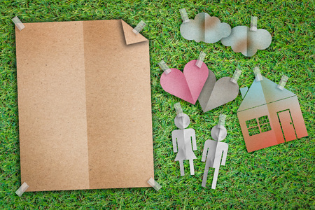 home sweet home concept with family icon paper cut flat style and blank notebook with free copy space on green grass background