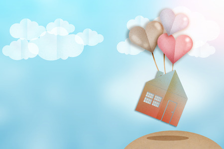 flying house with heart balloons paper cut flat style love concept Stock Photo
