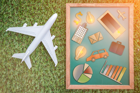 comunication: business comunication icon on green background with plane on grass floor business concept