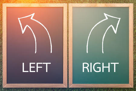 bidirectional: right left and arrow drawn with chalk on a blackboard life decision concept