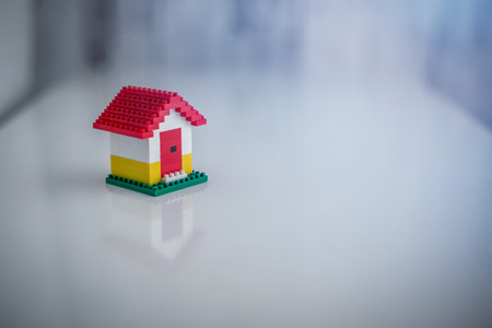 building loan: model of plastic house building, loan, real estate or buying a new home concept.with copy space