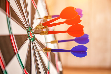 transcend: Red dart arrow hitting in the target center of dartboard business success ideas concept