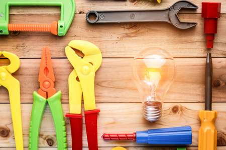 leveler: tools and instruments toys with light bulb on wood texture creativity ideas concept with copy space four yourtext