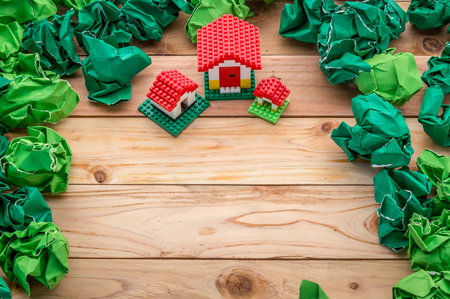 buying real estate: model of plastic house building with trash paper balls, loan, real estate or buying a new home concept.with copy space