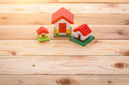 buying real estate: model of plastic house building, loan, real estate or buying a new home concept.with copy space