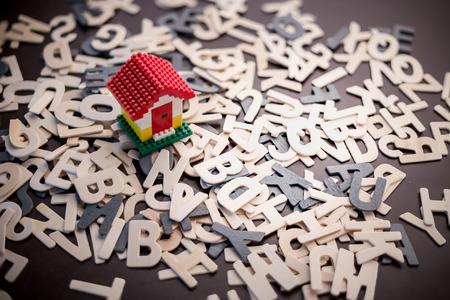 toy house: house concept mini toy house on wooden alphabet background creativity ideas concept Stock Photo