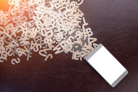 os: heaps os wooden alphabet fly from smartphone creativity ideas concept,business stretegy success Stock Photo