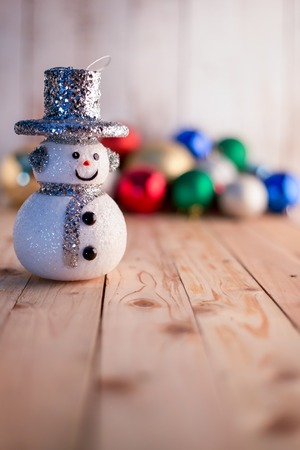Christmas background with snowman on a rustic wooden board Stock Photo