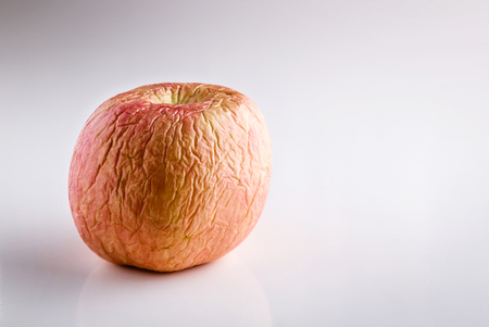 rotten apple ,Wizened skin,Still life on white background