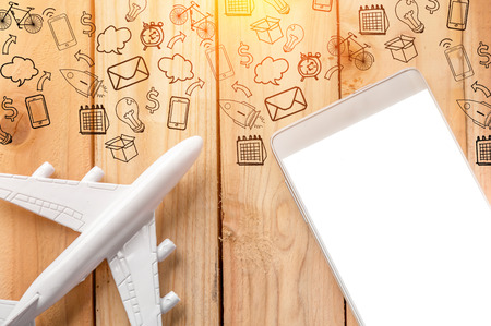 plane table: blank smartphone with plane toy and business icon on wooden table