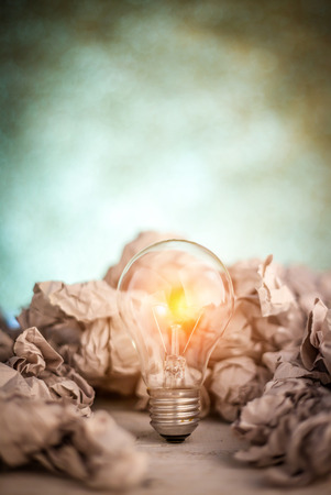 image of trash paper balls with bulb for brain storm concept Stock Photo
