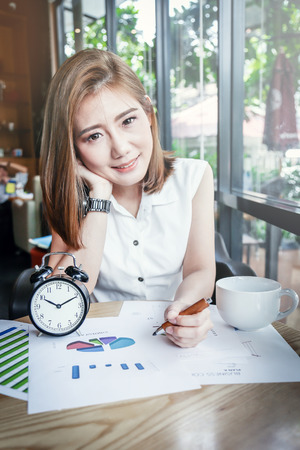 cute asian girl working in cafe with happy and relax feeling business concept