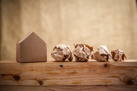 model home: model of paper house building with trash paper balls, loan, real estate or buying a new home concept.with copy space