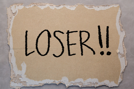 loser: loser text on card board paper on grey background Stock Photo