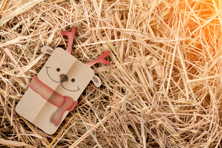 bale: snowman papercut style on hay background christmas concept festive greeting cards Stock Photo