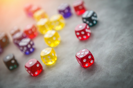 buy shares: colorful glass dice selective focus business ideas concept Stock Photo