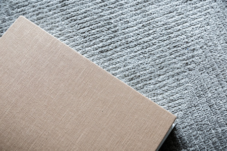 grey rug: sketch book wite free copyspace on grey rug texture background Stock Photo