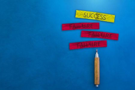wooden pencil: BUSINESS SUCCESS CONCEPT WITH SUCCESS AND FAILURE ON A PAPER NOTE WITH WOODEN PENCIL ON COLOR  LEATHER BACKGROUND AND FREE COPY SPACE FOR YOUR CREATIVITY IDEAS CONCEPT