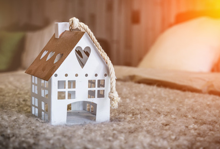 home sweet home house model on fabric  beige color with light flare effect