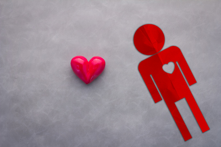 truelove: human paper cut shape with red heart object on grey background with free copy space for your text love ideas theme