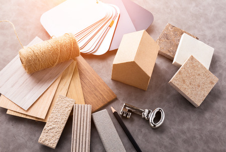 house design concept with house paper mockup model and material sample with stone, sample wood ,sample color,pencil with free copy space for yout ideas text Stock Photo