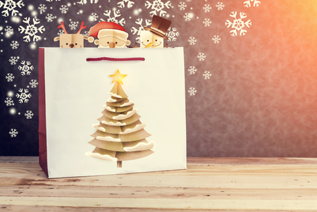 paperbag: Festive white paper-bag with christmas tree, snowflakes and christmas cartoon papercut style with free copy space for your text