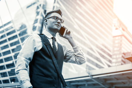 Middle-aged businessman having phone call outdoors Stock Photo