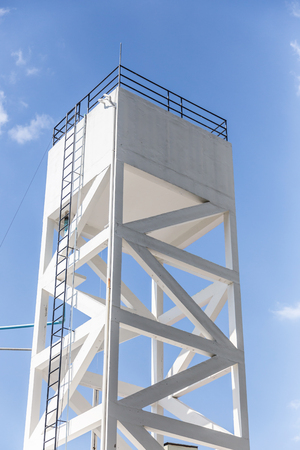 white water tank building with nice clear sky background