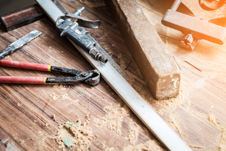 wood workshop with handcraft tools and raw wood on construction site Stock Photo