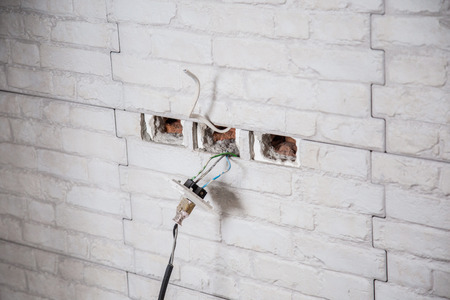 #73058994   House Work Electricity Outlet Wiring In The Wall Construction  Concept