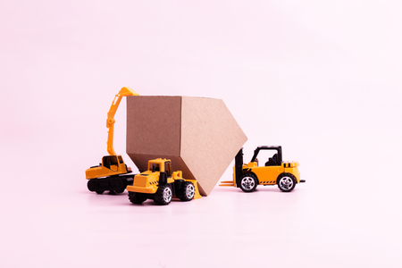 house construction business ideas concept with house cardboard paper and toy car with free copyspace for your text