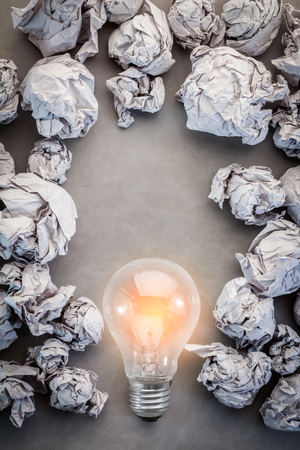 crumpled wringled paper texture background creativity ideas concept with glow light bulb with free copyspace for your creativity ideas text Stock Photo