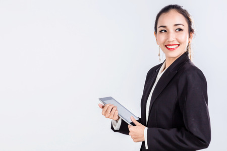 smart asian business woman in suit with tablet and white background Stock Photo