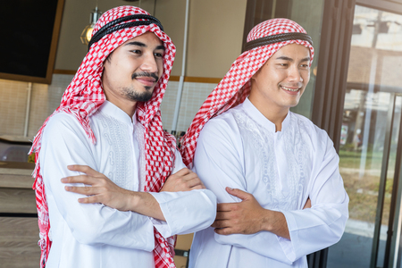 arabian business man smile and stand together joint venture business ideas concept