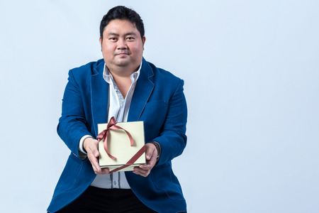 fat asian business man and present box with shirt isolate on white background