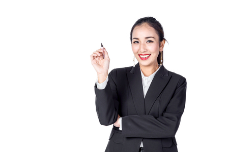 asian business woman smile  and show hand point to free copyspace area for your text