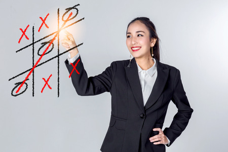 business asian woman win tic tac toe game