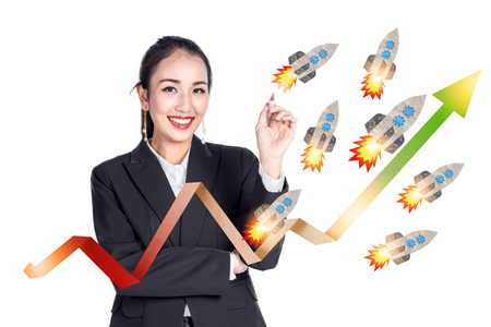 smart asian business girl point and present graph with rocket paper business ideas concept Stock Photo
