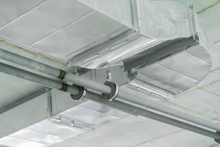 detial close up of air tunnel pipe work construction install on building concrete ceiling construction concept