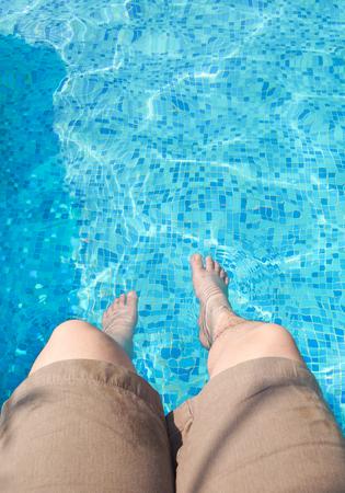 soak: Sitting with foot soak in swimming pool