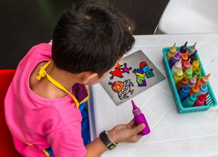 Children dripping paint art Stock Photo