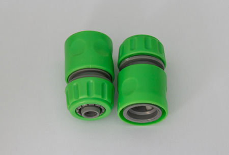 connector: water hose connector on white background Stock Photo