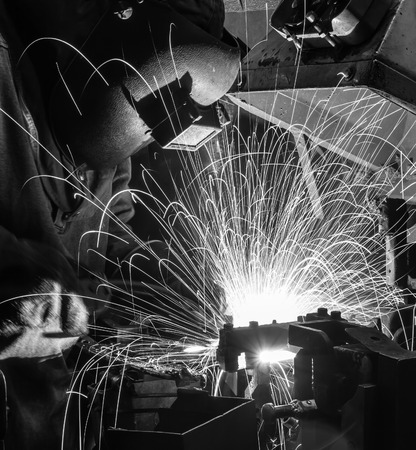 prefabricate: Welder movement Industrial automotive part in factory black white