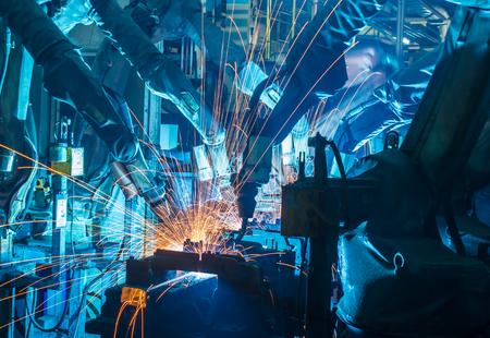 welding: Team Robot welding movement Industrial automotive part in factory Stock Photo